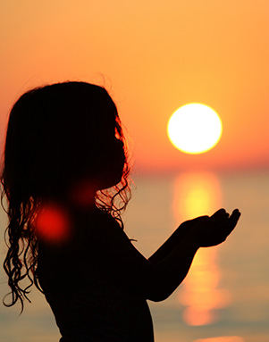 Child and sunset
